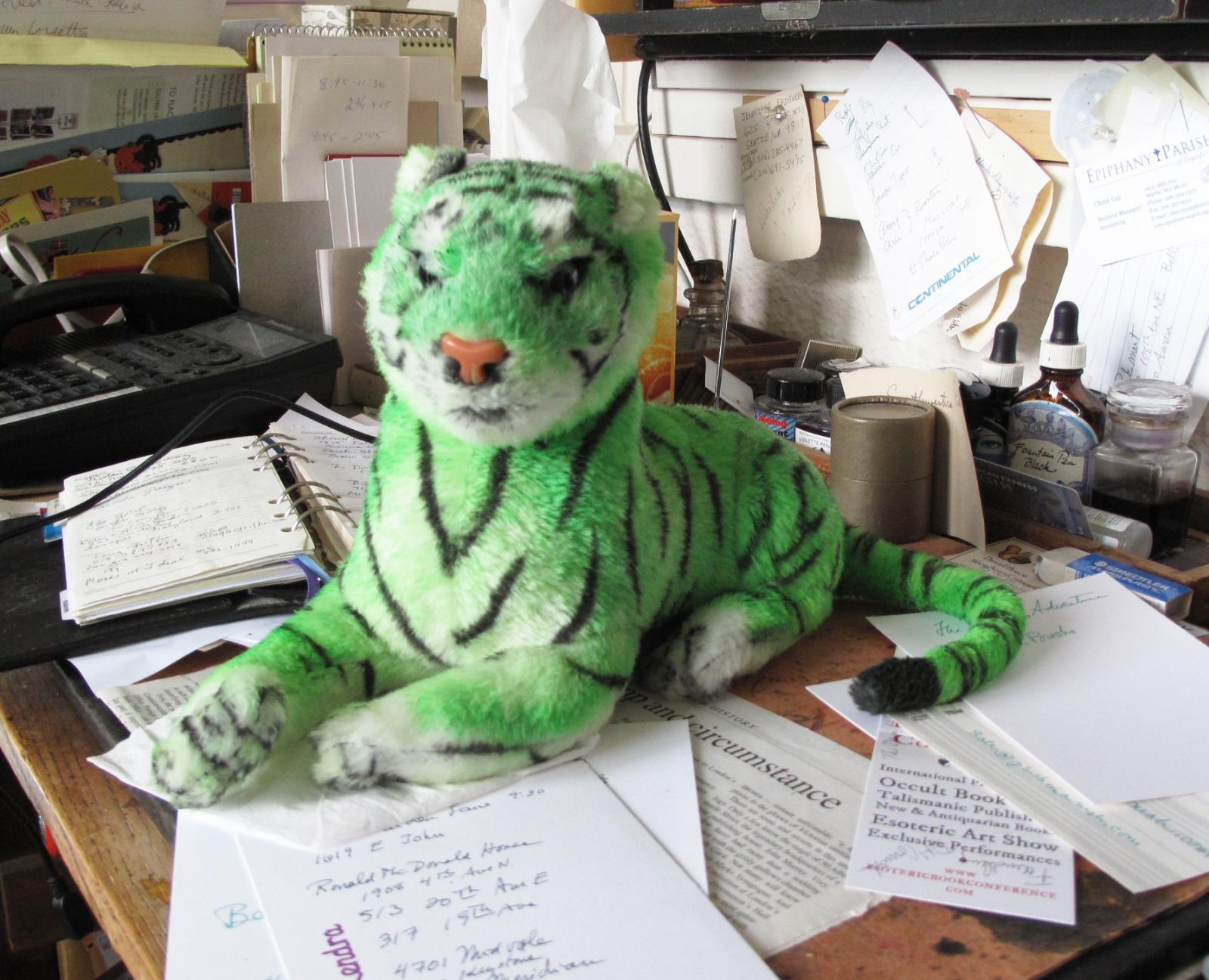 Green Tiger Guarding the Desk