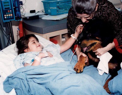 Carl visiting a child in a hospital