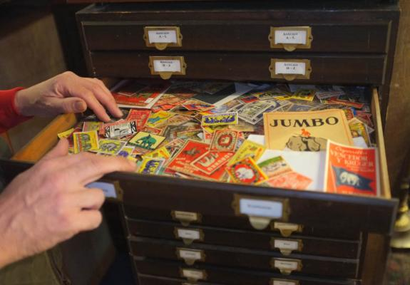 an open drawer showing a large assortment of elephant matchbook labels