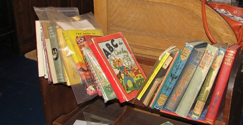 a shelf of old children's books, including several John Martin's Big Book